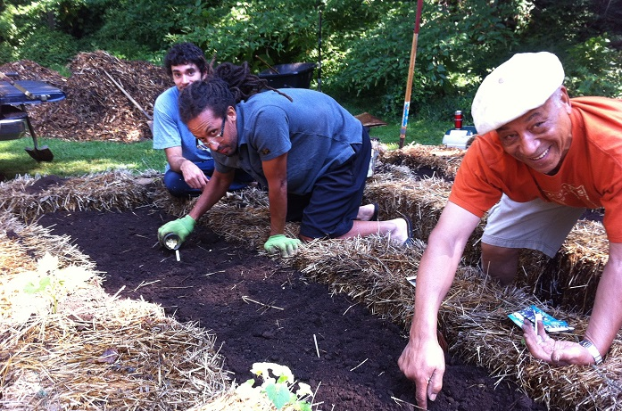 Bryan Twyman and Zora Lloyd seeding the ground at Permacultivate's urban farm site. Photo (CC): Sarah Jacobson
