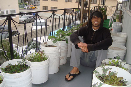 Mike Lieberman sitting amongst his Los Angeles balcony garden containers. Photo credit: Urban Organic Gardener.