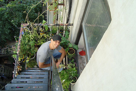 Mike Lieberman in his New York City fire escape garden. Photo credit: Urban Organic Gardener.