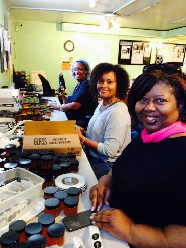 Brenda Palms Barber and Sweet Beginnings team members packaging beeloveTM products. © Sweet Beginnings, LLC