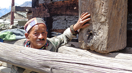 Nashala village farmer Lihat Ram is using a traditional log hive to help native pollinators thrive. Photo by Pradeep Metha