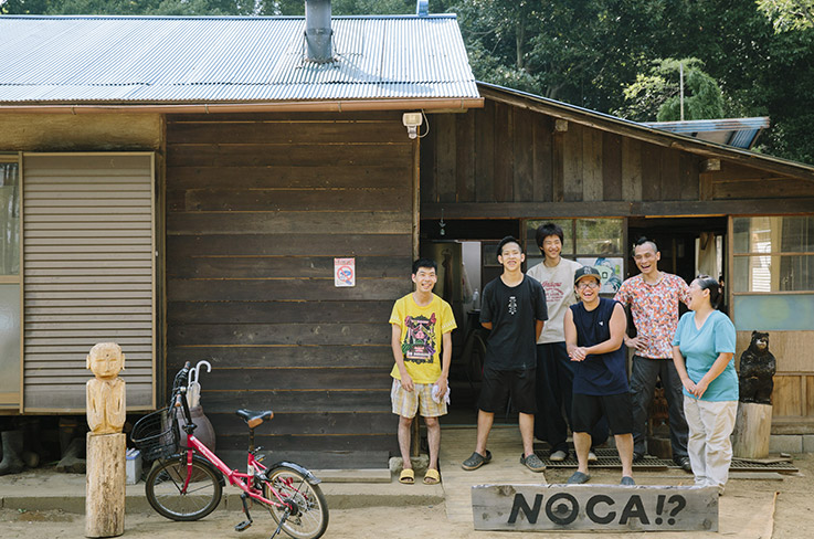 NOCA?! associate Mrs. Haruka and project founder Ali Kawakita with Yōsuke, Shûji, Shûto and Yûtarō in front of the NOCA?! House, where six young adults between the ages of 17 and 25 live together. © Masaya Tanaka